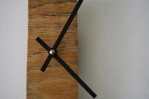 narrow wooden clock
